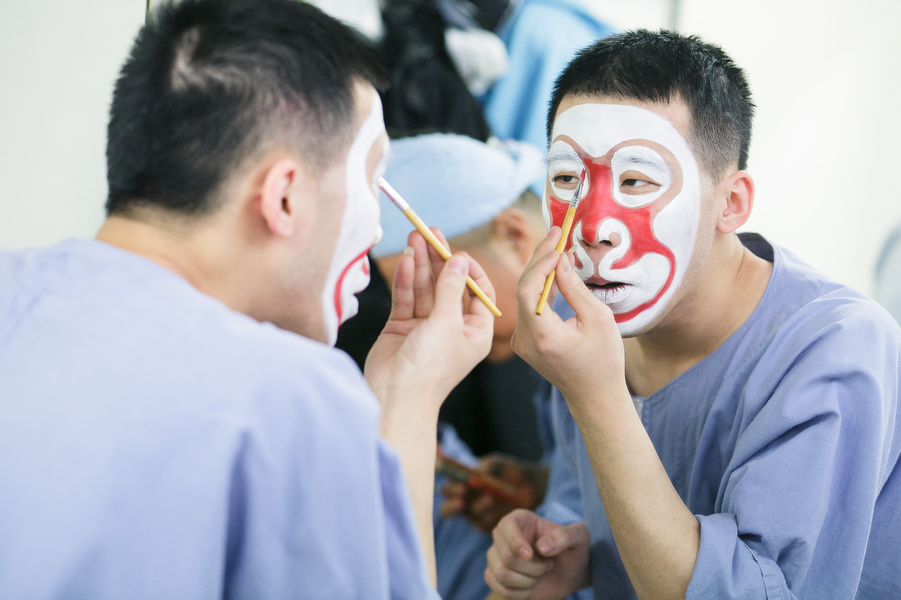 An actor puts on makeup before the China National Peking Opera Company performance of the Monkey King in Cankarjev dom Culture and Congress Center in Ljubljana, Slovenia, Dec. 31, 2015.