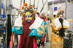 Ma a Long who plays the Horse King (L) and Gu Qian who plays the Jade Emperor (R) fit their beards before the China National Peking Opera Company performance of the Monkey King in Cankarjev dom Culture and Congress Center in Ljubljana, Slovenia, Dec. 31, 2015.
