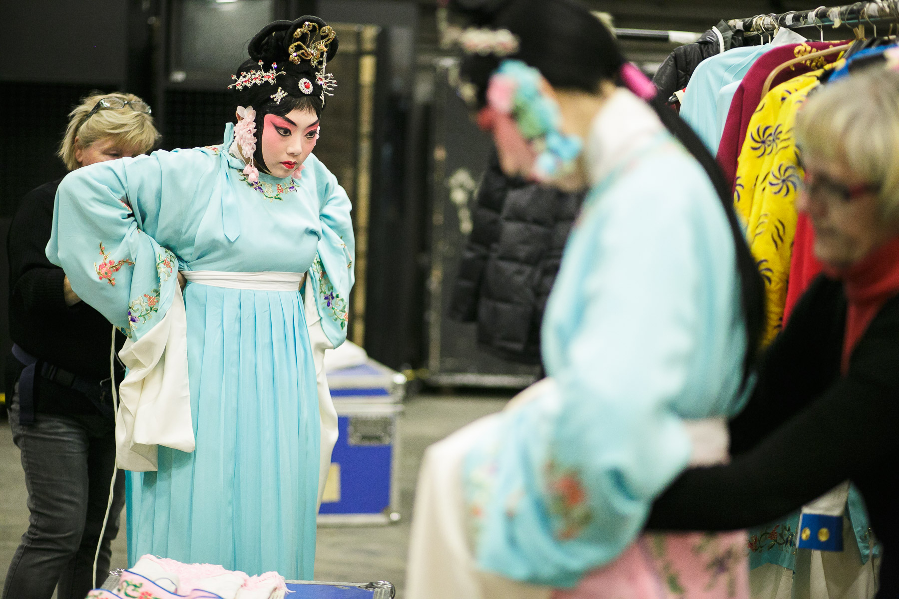 Actresses put on their costumes before the China National Peking Opera Company performance of the Monkey King in Cankarjev dom Culture and Congress Center in Ljubljana, Slovenia, Dec. 31, 2015.