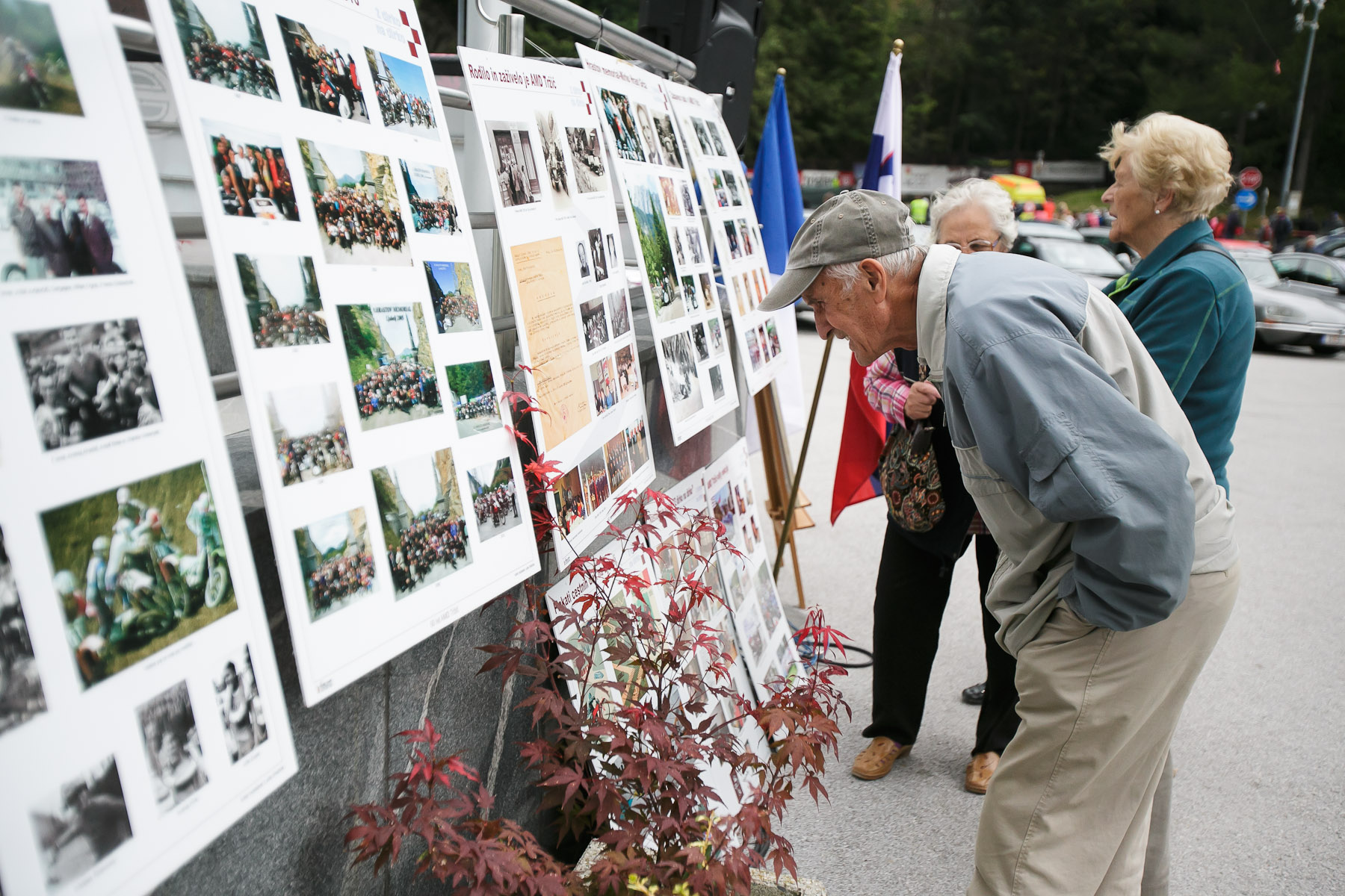 People admire the exhibition of photographs showing the history of the oldtimers\' race at the 19th Hrast Memorial, the international oldtimers\' mountain race in Ljubelj, Slovenia, Sep. 13, 2015.
