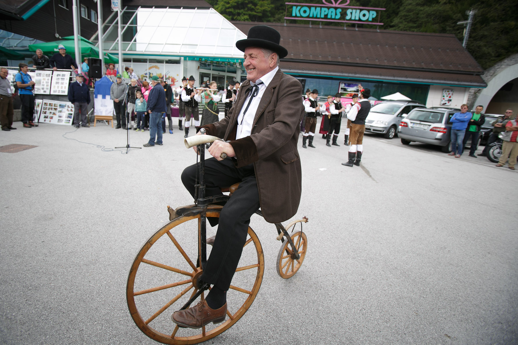 A man rides an old wooden bicycle at the opening ceremony of the 19th Hrast Memorial, the international oldtimers\' mountain race in Ljubelj, Slovenia, Sep. 13, 2015.