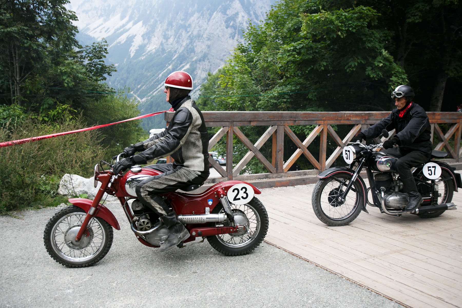 Janez Kopitar (SLO) on his 1958 Puch motorcycle and Viljem Krpic (SLO) on his 1953 Puch motorcycle head to the start line of the 19th Hrast Memorial, the international oldtimers\' mountain race in Ljubelj, Slovenia, Sep. 13, 2015.