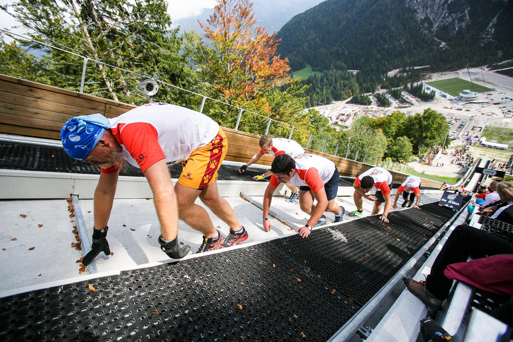 Competitors run up the ski flying hill during the Red Bull 400 race in Planica, Slovenia, Sep. 19, 2015.