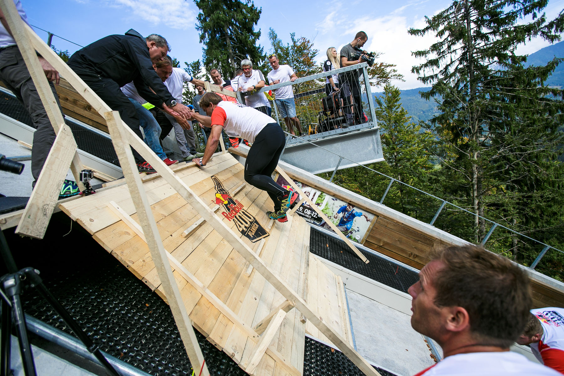 A competitor reaches the finish after running up the ski flying hill during the Red Bull 400 race in Planica, Slovenia, Sep. 19, 2015.