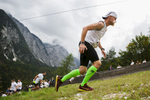 A competitor from the Planica 252 relay team runs up the ski flying hill during the Red Bull 400 race in Planica, Slovenia, Sep. 19, 2015.