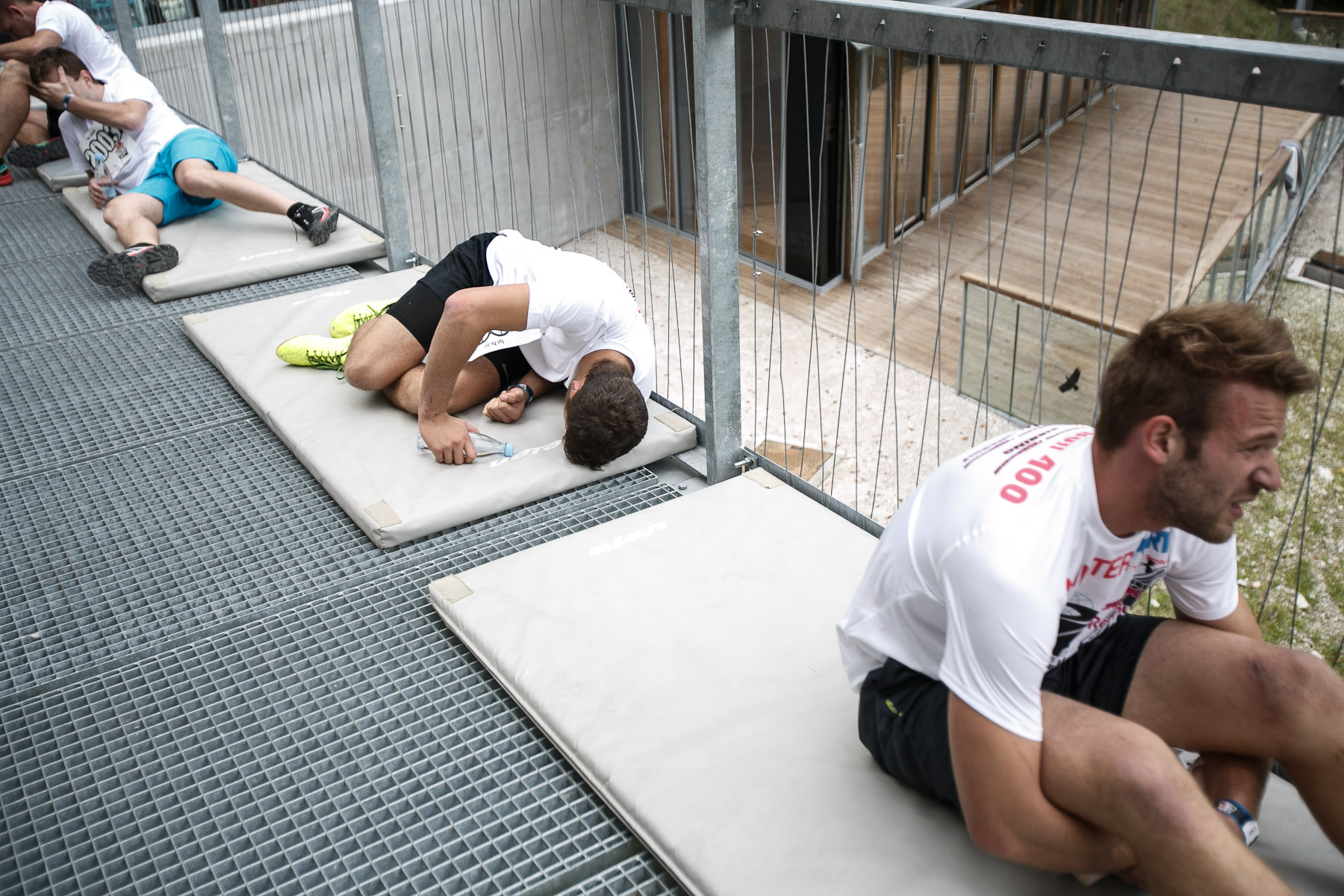 Exhausted competitors rest after running up the ski flying hill during the Red Bull 400 race in Planica, Slovenia, Sep. 19, 2015.