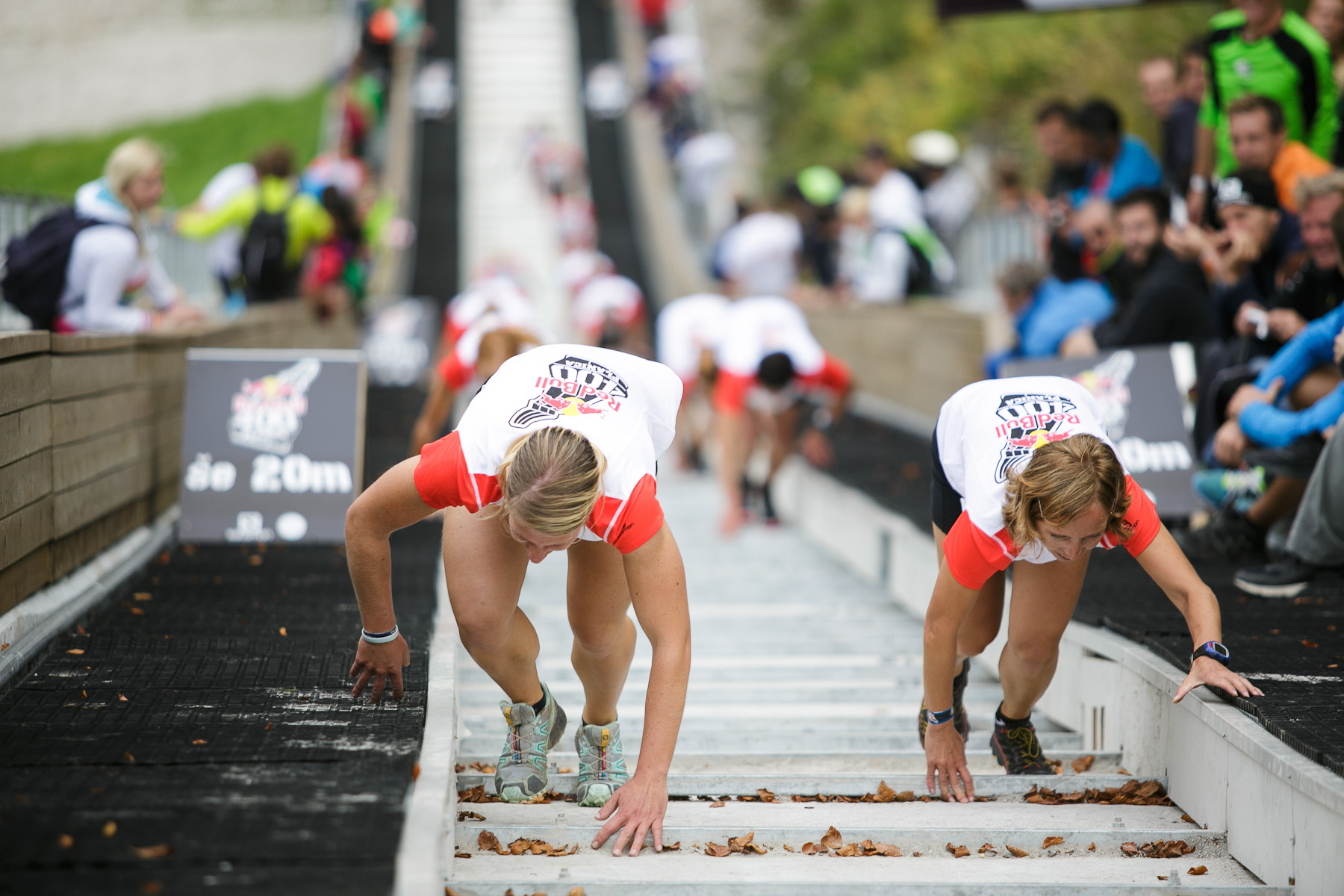 Karmen Klancnik (L) and Petra Miklosa (R) run up the ski flying hill during the Red Bull 400 race in Planica, Slovenia, Sep. 19, 2015.