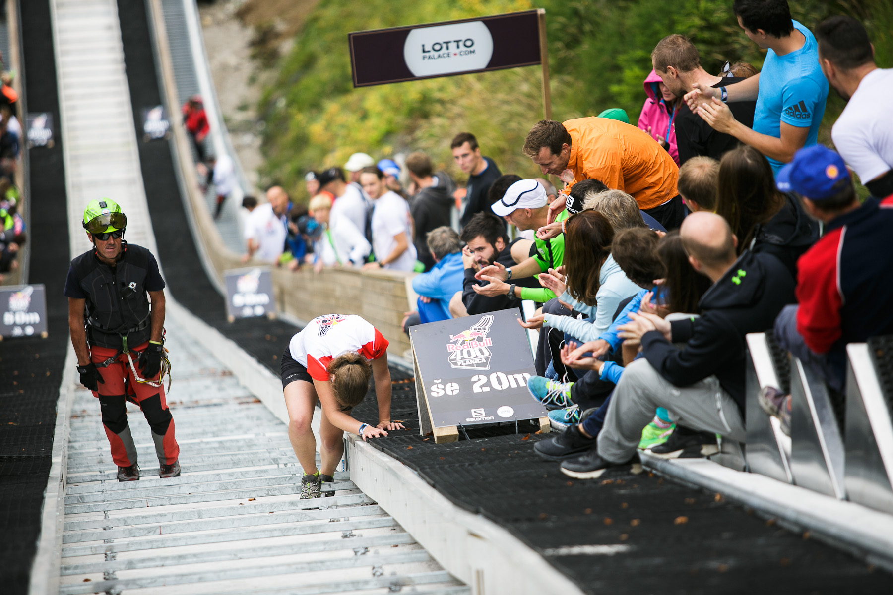 A competitor struggles to run up the ski flying hill during the Red Bull 400 race in Planica, Slovenia, Sep. 19, 2015.