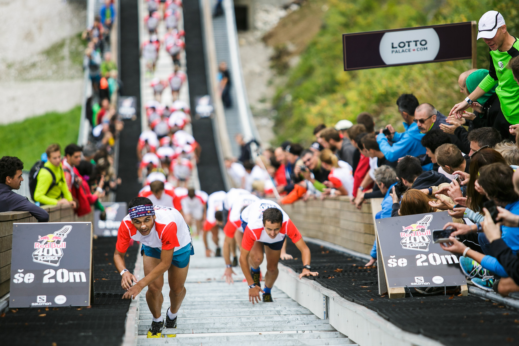 Winner Ahmet Arslan from Turkey (L) and second placed Luka Kovacic from Slovenia (R) run up the ski flying hill during the Red Bull 400 race in Planica, Slovenia, Sep. 19, 2015.