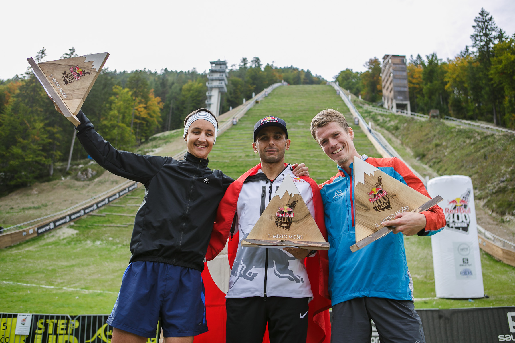 (L-R) Winners in the men competition: second placed Luka Kovacic (SLO), winner Ahmet Arslan (TUR) and third placed Nejc Kuhar (SLO) on the winners podium after the Red Bull 400 race in Planica, Slovenia, Sep. 19, 2015.