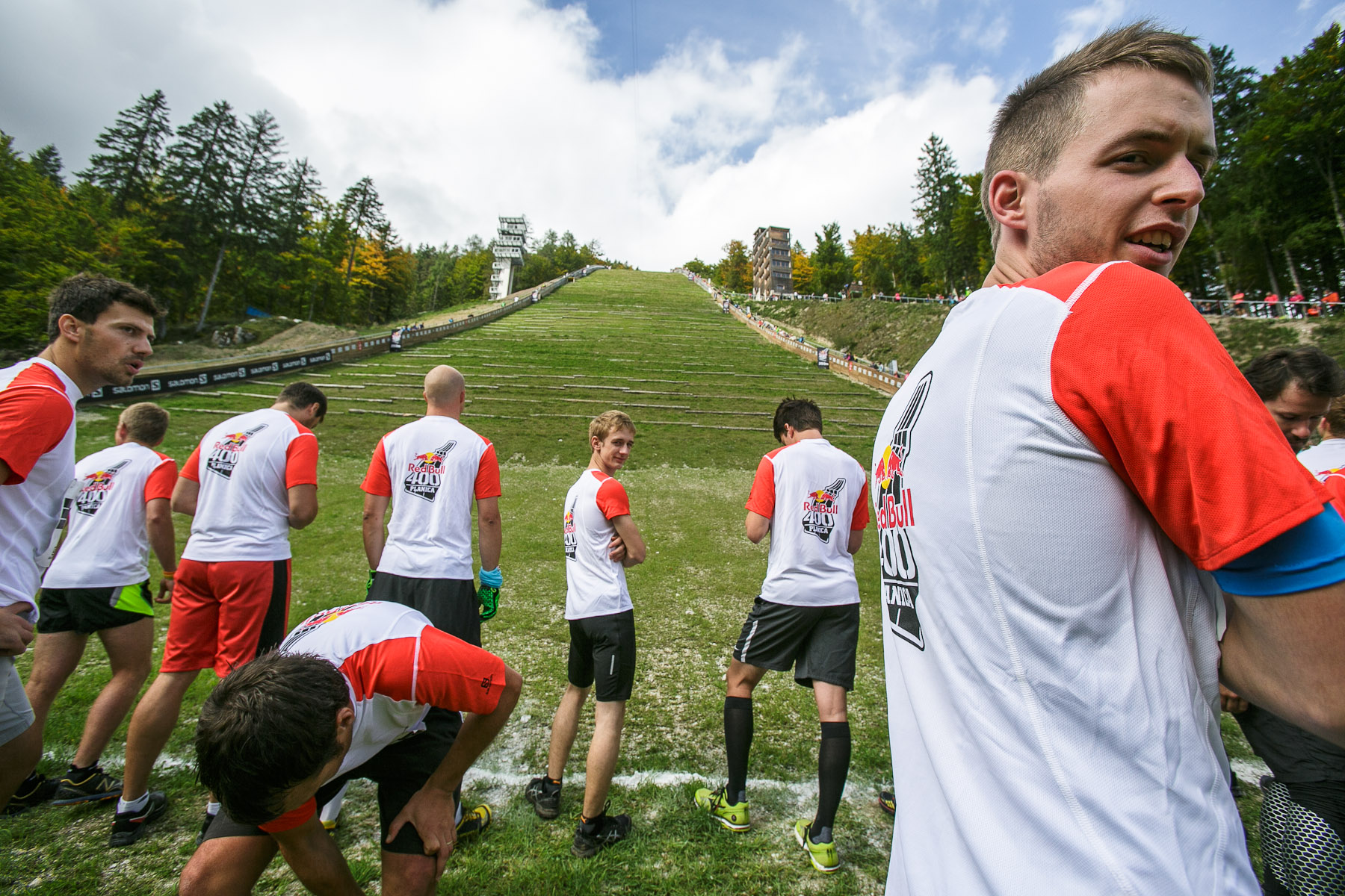 Competitors wait at the starting line before running up the ski flying hill during the Red Bull 400 race in Planica, Slovenia, Sep. 19, 2015.