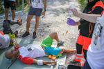 An exhausted competitor receives first aid  after running up the ski flying hill during the Red Bull 400 race in Planica, Slovenia, Sep. 19, 2015.