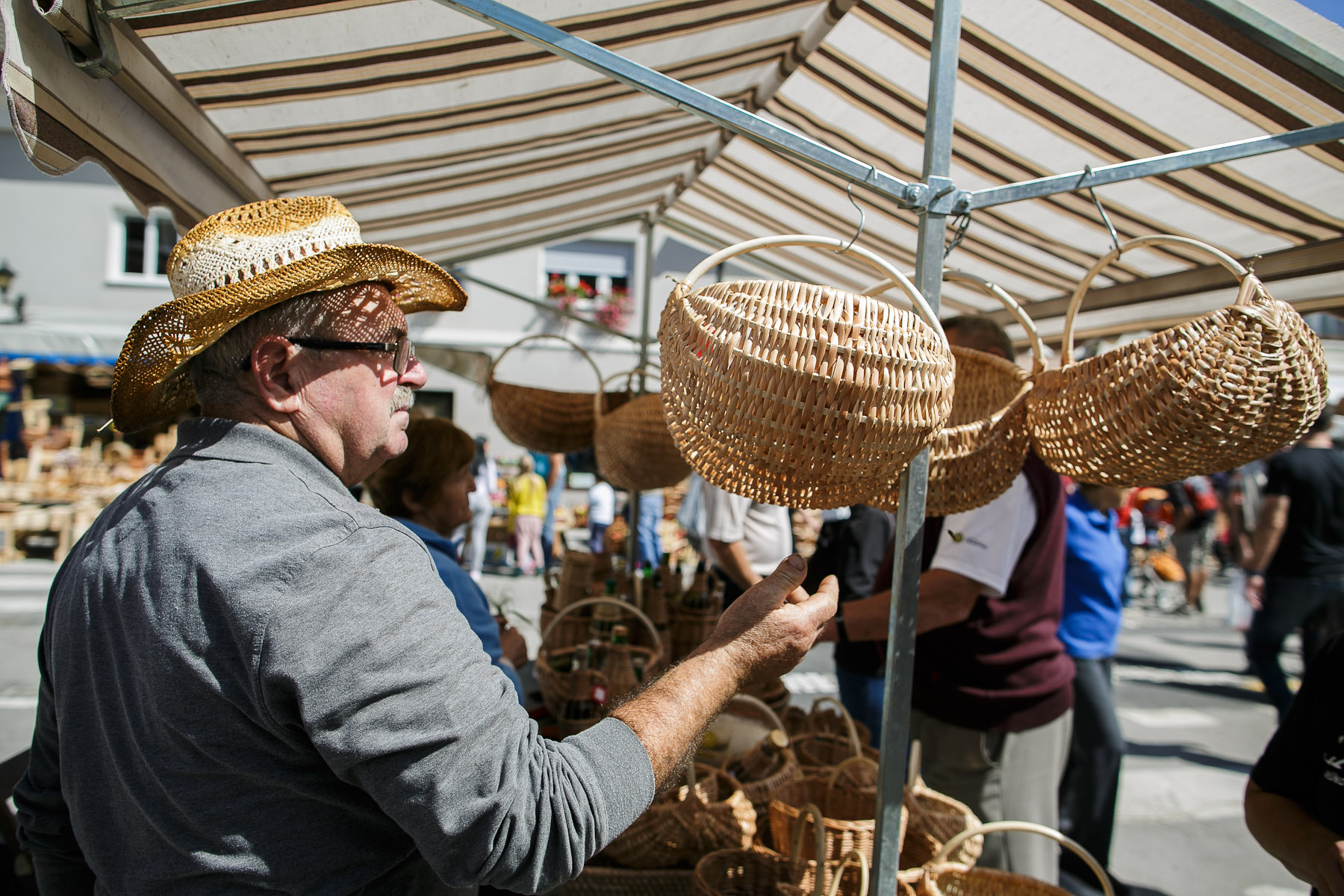 A man in a straw hat observes wooden baskets at the 40th traditional woodenware fair in Ribnica, Slovenia, Sep. 6, 2015.