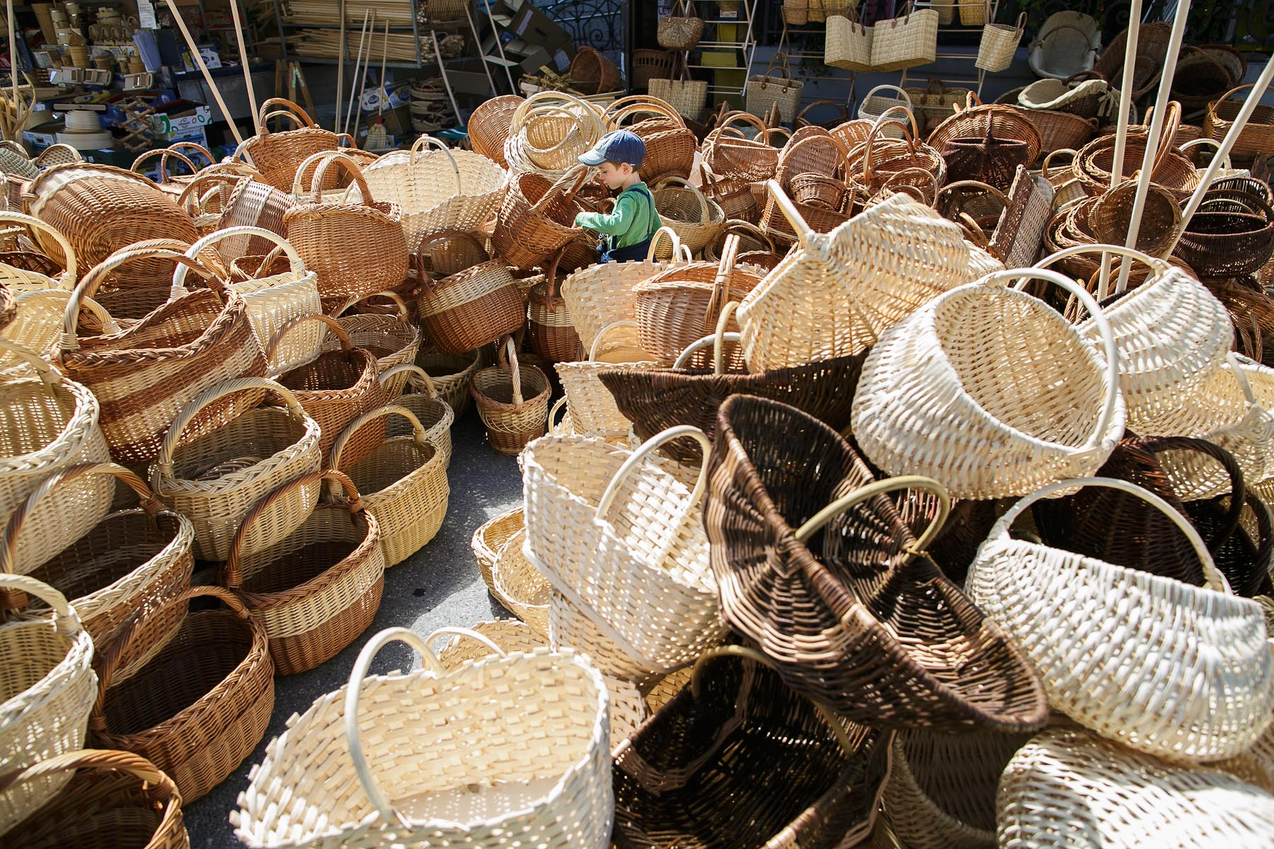 A boy observes wooden baskets at the 40th traditional woodenware fair in Ribnica, Slovenia, Sep. 6, 2015.