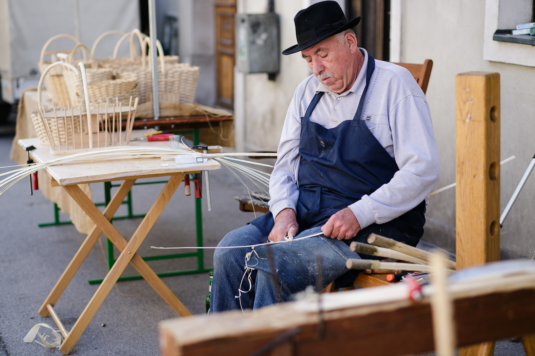 A man cuts wicker to make a basket at the 40th traditional woodenware fair in Ribnica, Slovenia, Sep. 6, 2015.