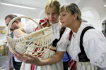 Women from Czech Republic wearing folk costumes admire a wooden basket at the 40th traditional woodenware fair in Ribnica, Slovenia, Sep. 6, 2015.