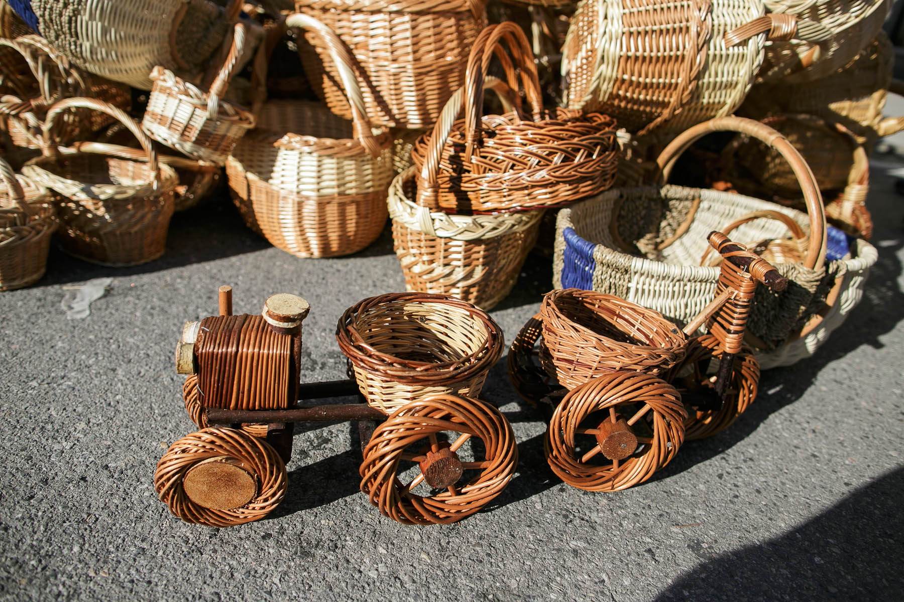 Weaved wooden tractor and bicycle are sold at the 40th traditional woodenware fair in Ribnica, Slovenia, Sep. 6, 2015.