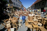 A boy walks among the woodenware during the 40th traditional woodenware fair in Ribnica, Slovenia, Sep. 6, 2015.