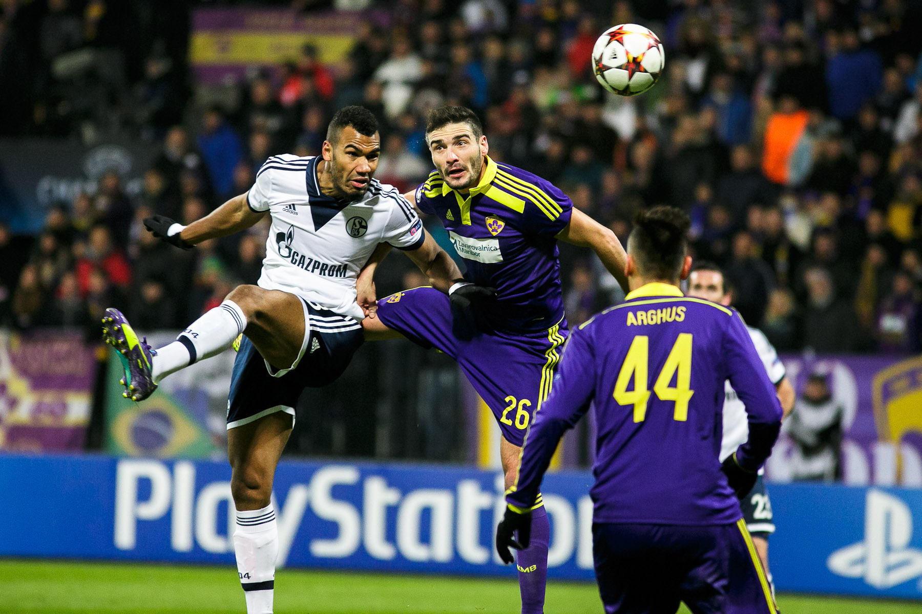 Eric Maxim Choupo-Moting of FC Schalke 04 is challenged by Aleksander Rajcevic of NK Maribor during the UEFA Champions League Group G match on December 10 in Maribor, Slovenia.