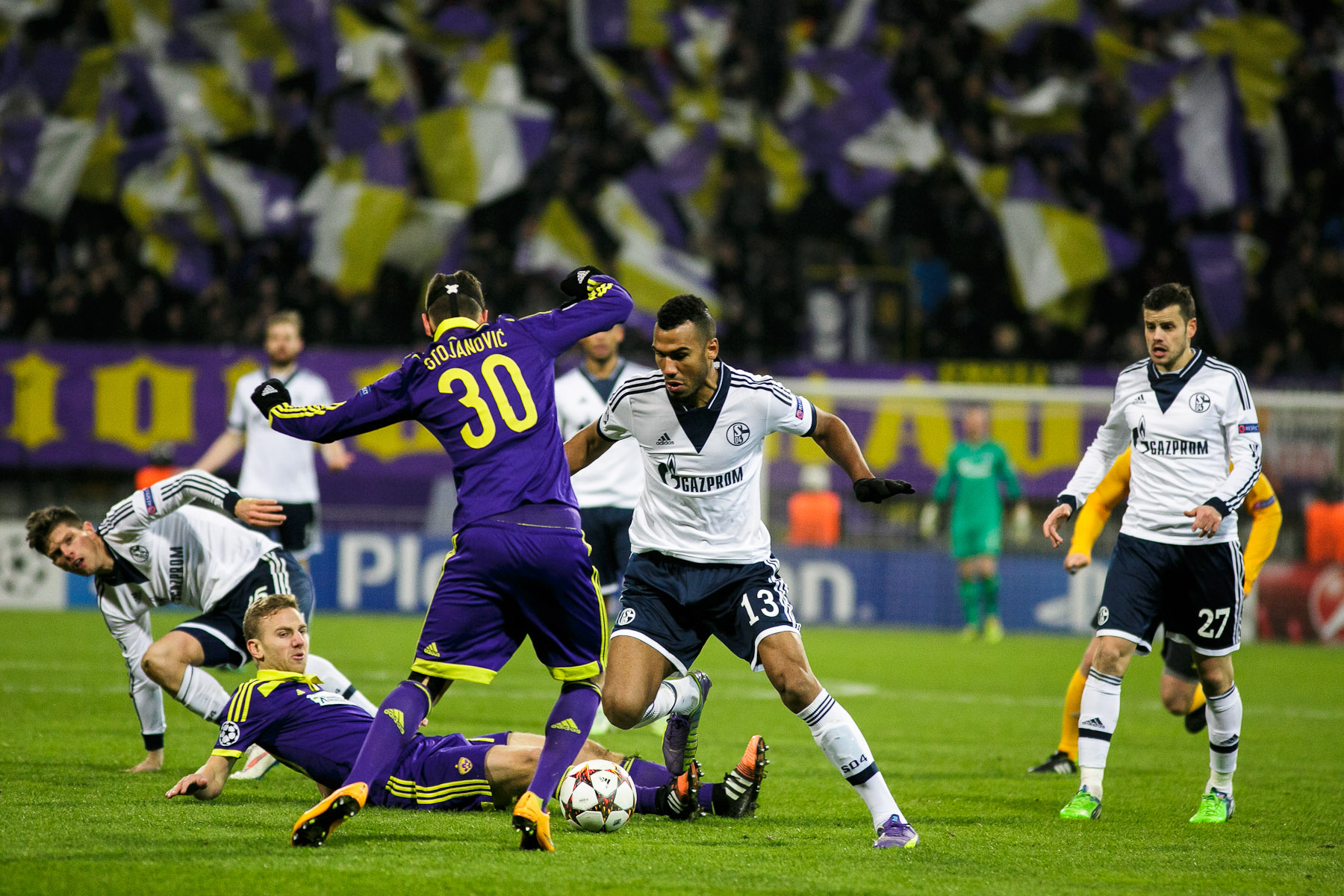 Eric Maxim Choupo-Moting of FC Schalke 04 is challenged by Petar Stojanovic of NK Maribor during the UEFA Champions League Group G match on December 10 in Maribor, Slovenia.