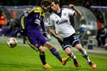 Christian Fuchs of FC Schalke 04 is challenged by Petar Stojanovic of NK Maribor during the UEFA Champions League Group G match on December 10 in Maribor, Slovenia.