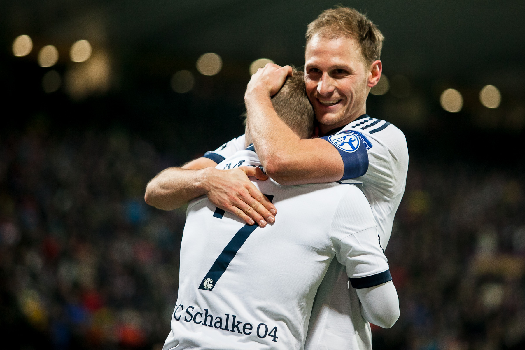 Benedikt Hoewedes of FC Schalke 04 hugs his teammate Max Meyer who scored against NK Maribor during the UEFA Champions League Group G match on December 10 in Maribor, Slovenia.