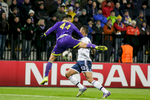 Eric Maxim Choupo-Moting of FC Schalke 04 is challenged by Arghus of NK Maribor during the UEFA Champions League Group G match on December 10 in Maribor, Slovenia.