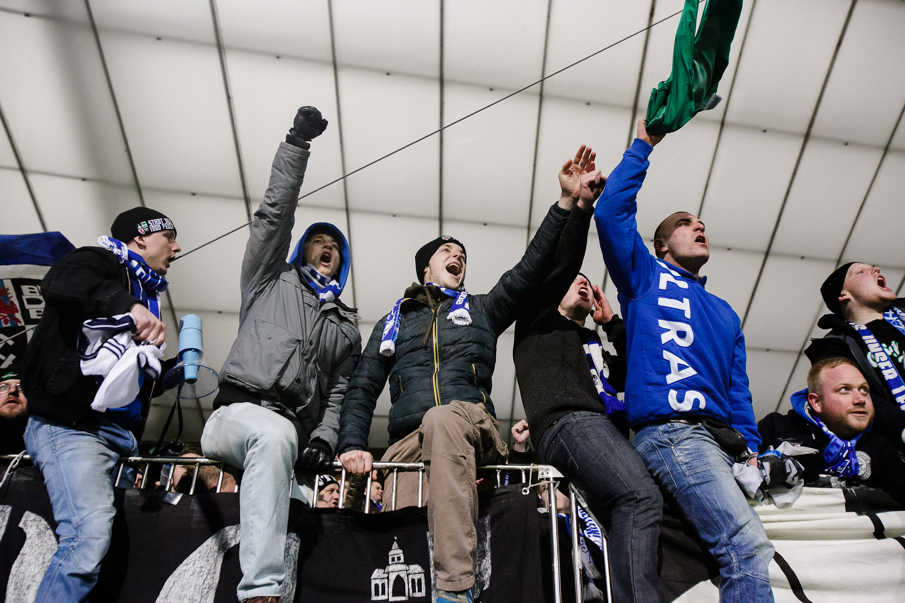 FC Schalke 04 fans cheer during the UEFA Champions League Group G match between FC Schalke 04 and NK Maribor on December 10 in Maribor, Slovenia.