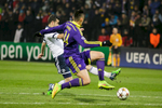 Tranquillo Barnetta of FC Schalke 04 is challenged by Arghus of NK Maribor during the UEFA Champions League Group G match on December 10 in Maribor, Slovenia.