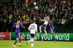 Christian Fuchs of FC Schalke 04 and Sintayehu Sallalich of NK Maribor jump for the ball during the UEFA Champions League Group G match on December 10 in Maribor, Slovenia.