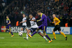 Dennis Aogo of FC Schalke 04 is challenged by  Zeljko Filipovic of NK Maribor during the UEFA Champions League Group G match on December 10 in Maribor, Slovenia.