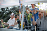 Spectators take photographs of the pits from behind the fence before the Mitas Slovenian FIM Speedway Grand Prix at Matija Gubec Stadium in Krsko, Slovenia, Sep. 12, 2015.