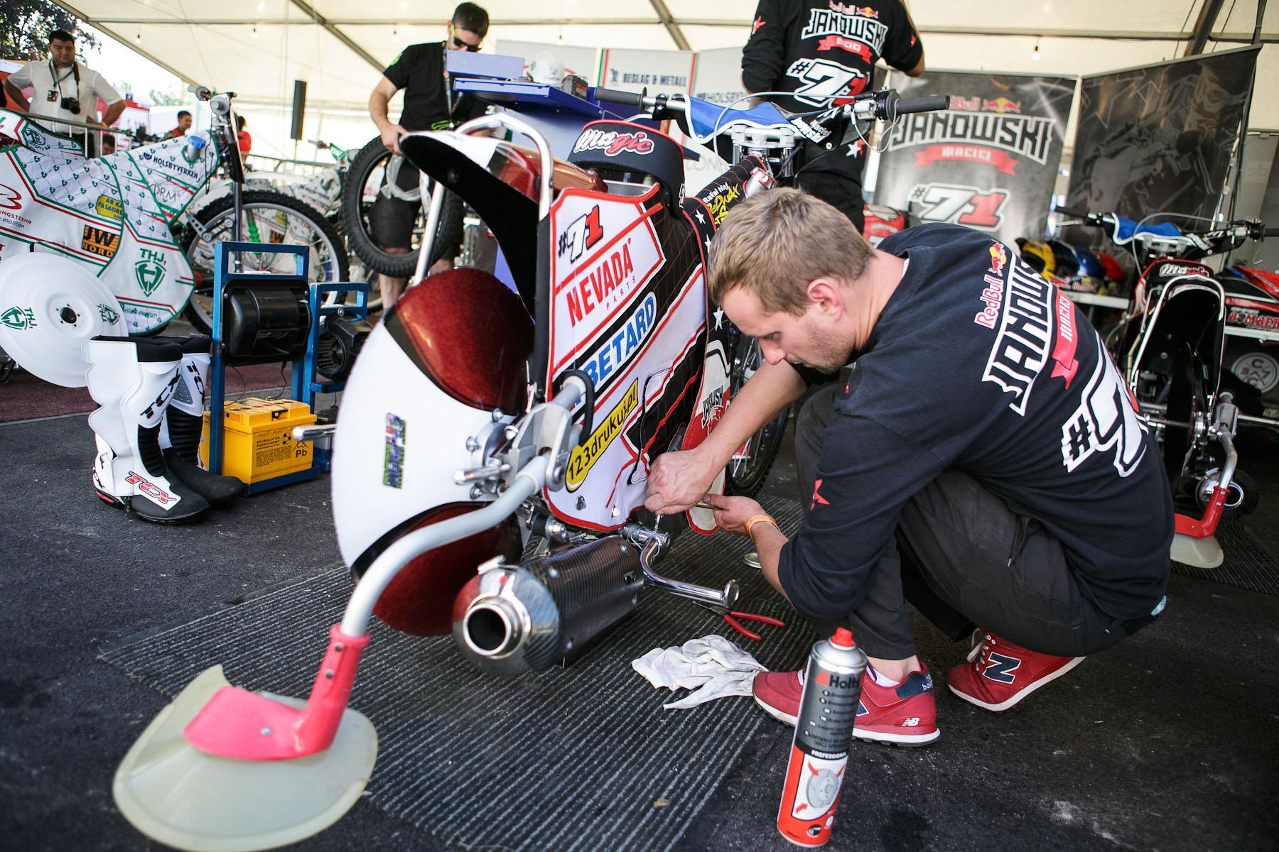 Poland\'s Maciej Janowski\'s technical team prepares the motorcycle before the Mitas Slovenian FIM Speedway Grand Prix at Matija Gubec Stadium in Krsko, Slovenia, Sep. 12, 2015.
