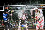 Tai Woffinden of Great Britain, Greg Hancock of USA  and Peter Kildemand of Denmark spray themselves with champagne on the winners podium of the Mitas Slovenian FIM Speedway Grand Prix at Matija Gubec Stadium in Krsko, Slovenia, Sep. 12, 2015.