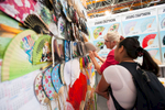 A visitor browses through Chinese fans in the Chinese hall at the 48th International Trade Fair in Celje, Slovenia, Sep. 8, 2015.