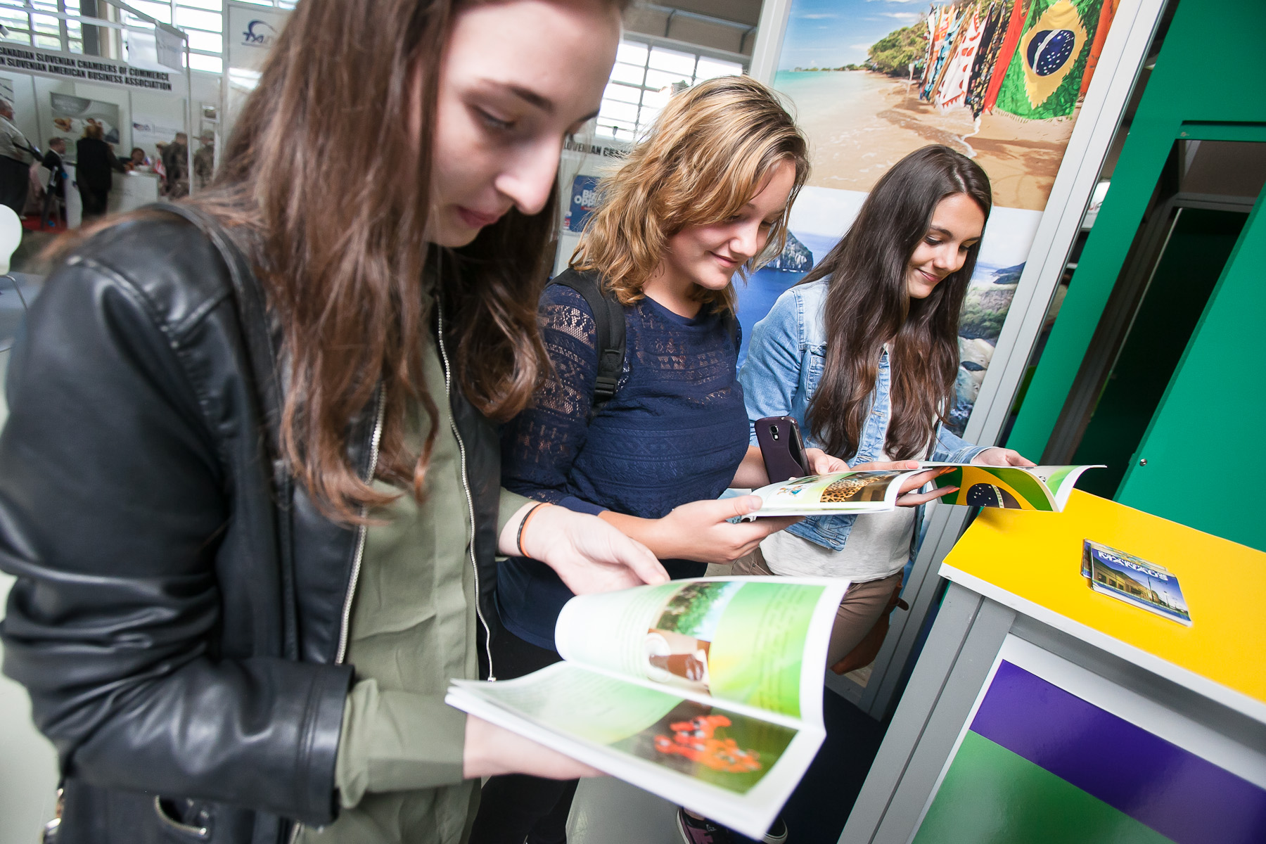 Visitors browse through catalogues of Brasil at the 48th International Trade Fair in Celje, Slovenia, Sep. 8, 2015.
