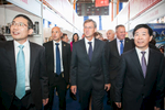 Slovenian Prime minister Miro Cerar (C) and the Ambassador of the People's Republic of China His Excellency Ye Hao (R) visit the hall dedicated to Chinese brands at the 48th International Trade Fair in Celje, Slovenia, Sep. 8, 2015.