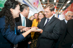Slovenian Prime minister Miro Cerar receives a gift  on his visit to the Chinese hall at the 48th International Trade Fair in Celje, Slovenia, Sep. 8, 2015.