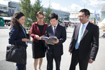 The Ambassador of the People's Republic of China His Excellency Ye Hao browses through the fair catalogue at the 48th International Trade Fair in Celje, Slovenia, Sep. 8, 2015.