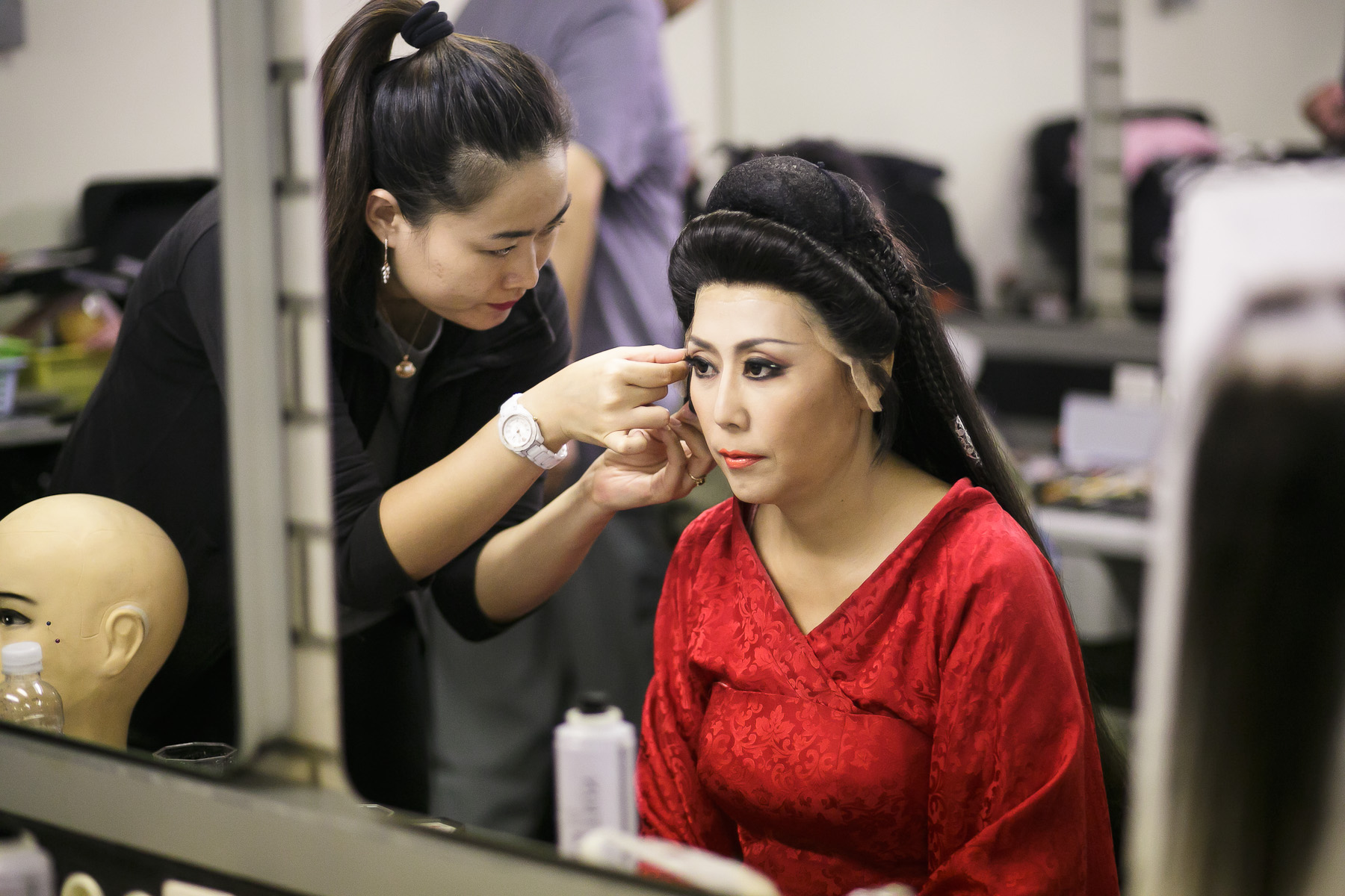 Wang Wei who plays Turandot in is fitted with a wig in make-up before her performance in China National Opera House production of Giacomo Puccini\'s Turandot in Cankarjev dom Cultural & Congress center in Ljubljana, Slovenia, Sep. 1, 2015.