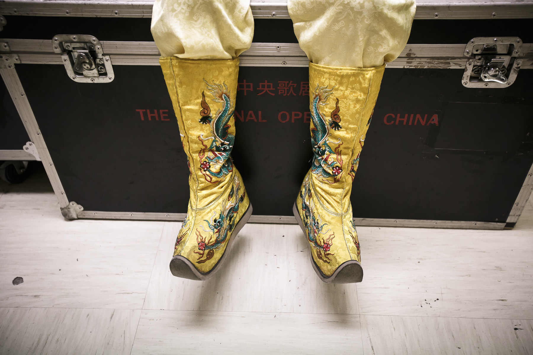 Wang Hai Min who plays the emperor sits on a crate backstage before his performance in China National Opera House production of Giacomo Puccini\'s Turandot in Cankarjev dom Cultural & Congress center in Ljubljana, Slovenia, Sep. 1, 2015.
