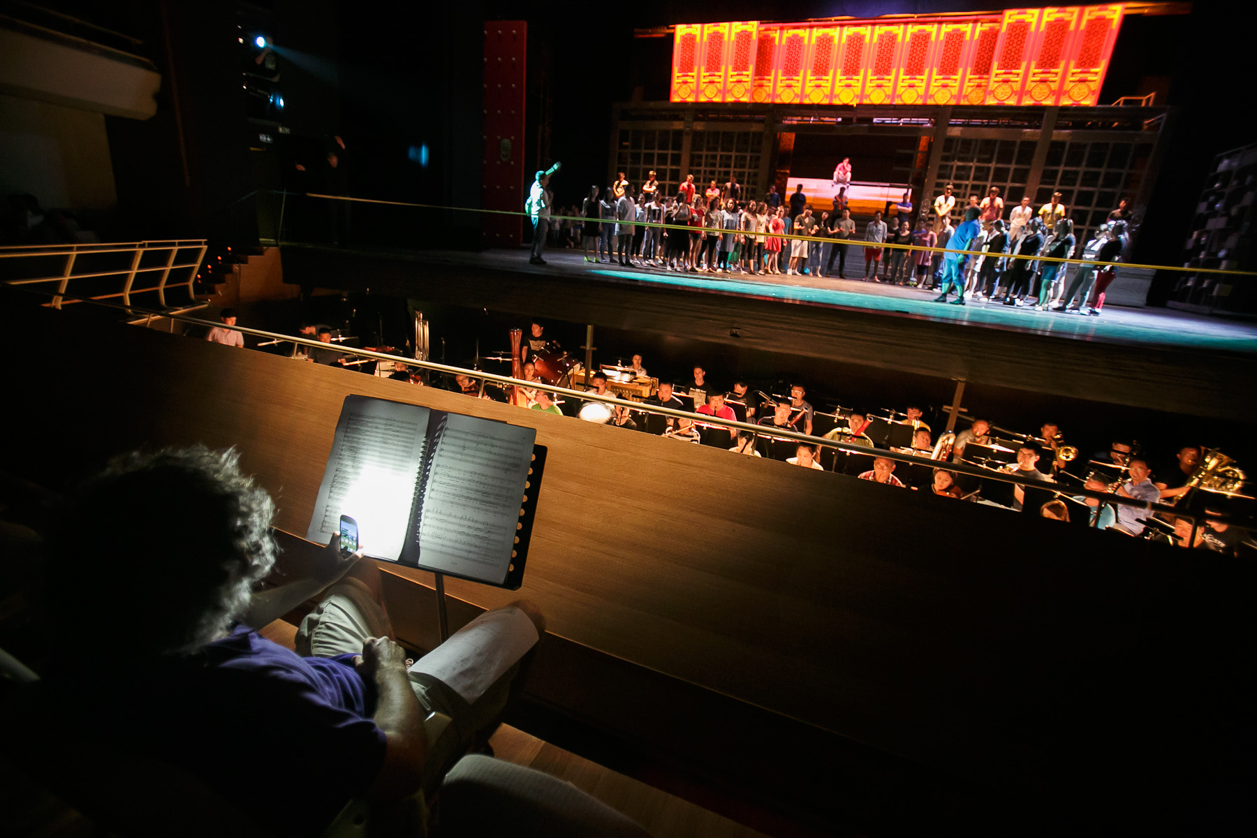 A man supervises music during the first rehearsal of China National Opera House production of Turandot in Cankarjev dom Cultural & Congress center in Ljubljana, Slovenia, Aug. 31, 2015.