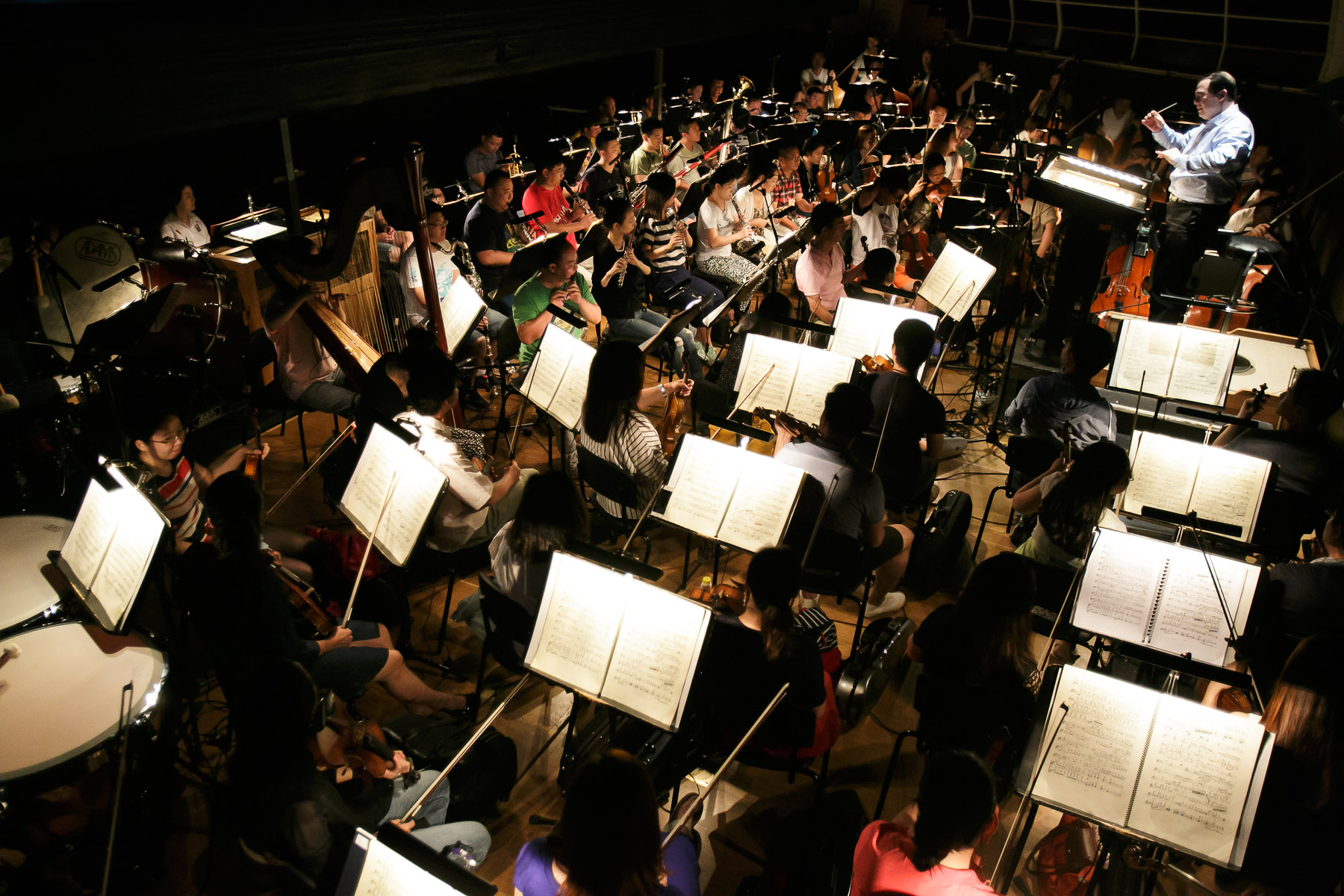 Conductor and artistic director of China National Opera House Yu Feng conducts the orchestra at the first rehearsal of Giacomo Puccini\'s Turandot in Cankarjev dom Cultural & Congress center in Ljubljana, Slovenia, Aug. 31, 2015.