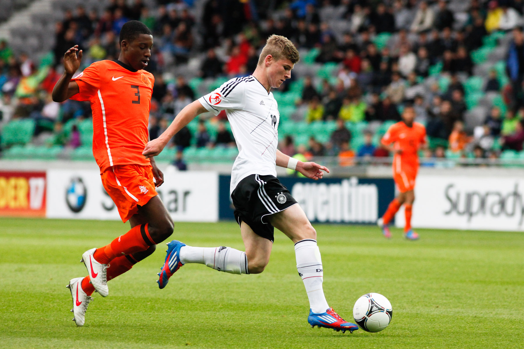 Timo Werner of Germany is challanged by Riechedly Bazoer of Netherlands during the UEFA U-17 European Championship final match between Germany and the Netherlands at the SRC Stozice Stadium in Ljubljana, Slovenia, May 16, 2012.