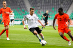 Maximilian Dittgen of Germany is challanged by Riechedly Bazoer of Netherlands during the UEFA U-17 European Championship final match between Germany and the Netherlands at the SRC Stozice Stadium in Ljubljana, Slovenia, May 16, 2012.