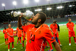 Tonny Trindade de Vilhena of Netherlands drinks from the European Championship cup after Team Netherlands won the UEFA U-17 European Championship finals at the SRC Stozice Stadium in Ljubljana, Slovenia, May 16, 2012.