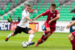 Marc Stendera of Germany is challanged by Sebastian Rudol of Poland during the UEFA U-17 European Championship semi-final match between Germany and Poland at the SRC Stozice Stadium in Ljubljana, Slovenia, May 13, 2012.