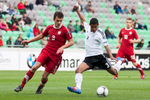 Jeremy Dudziak of Germany is challanged by Konrad Budek of Poland during the UEFA U-17 European Championship semi-final match between Germany and Poland at the SRC Stozice Stadium in Ljubljana, Slovenia, May 13, 2012.