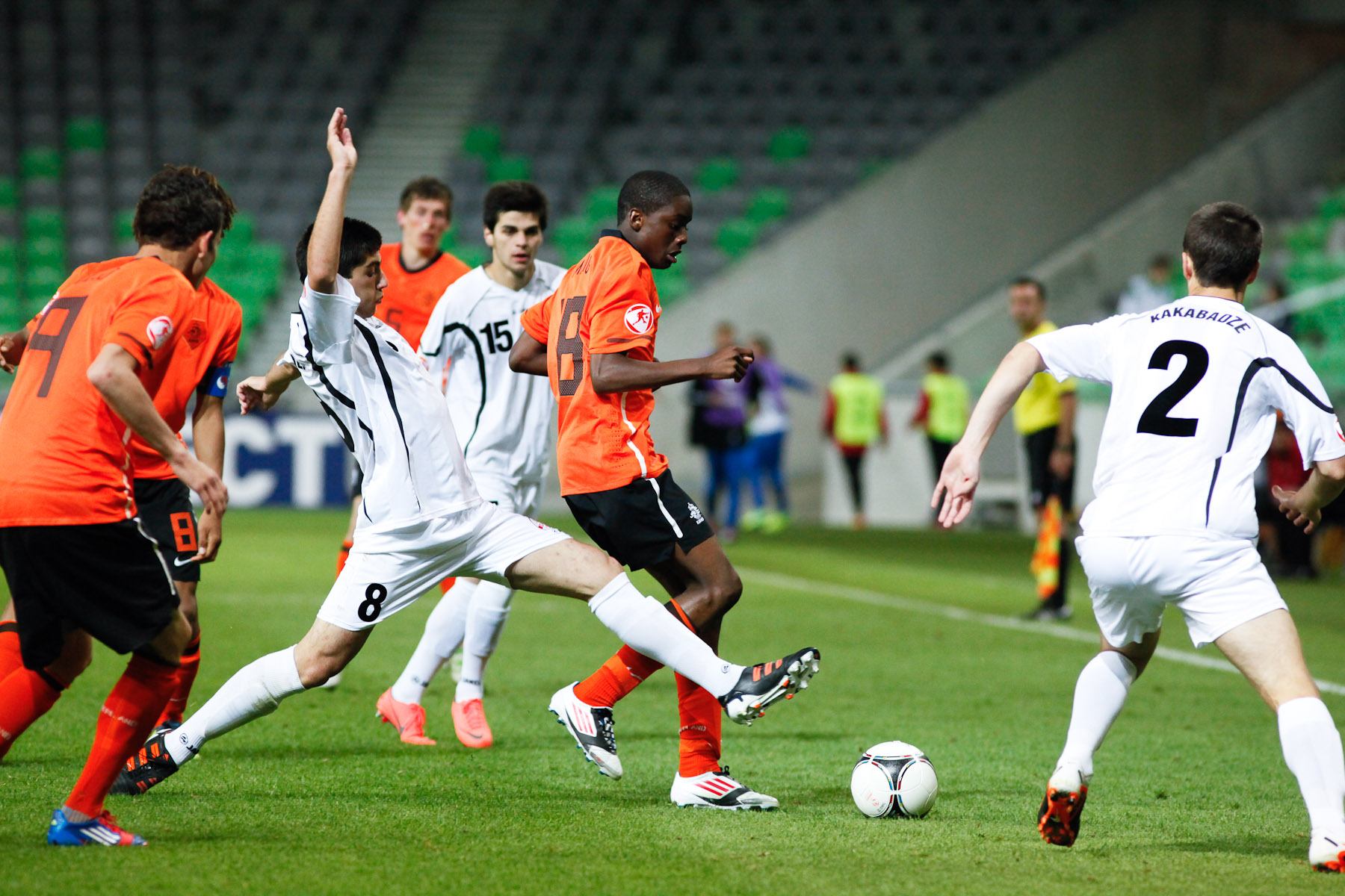 Queensy Menig of Netherlands is challanged by Giorgi Papunashvili of Georgia during the UEFA U-17 European Championship semi-final match between Netherlands and Georgia at the SRC Stozice Stadium in Ljubljana, Slovenia, May 13, 2012.