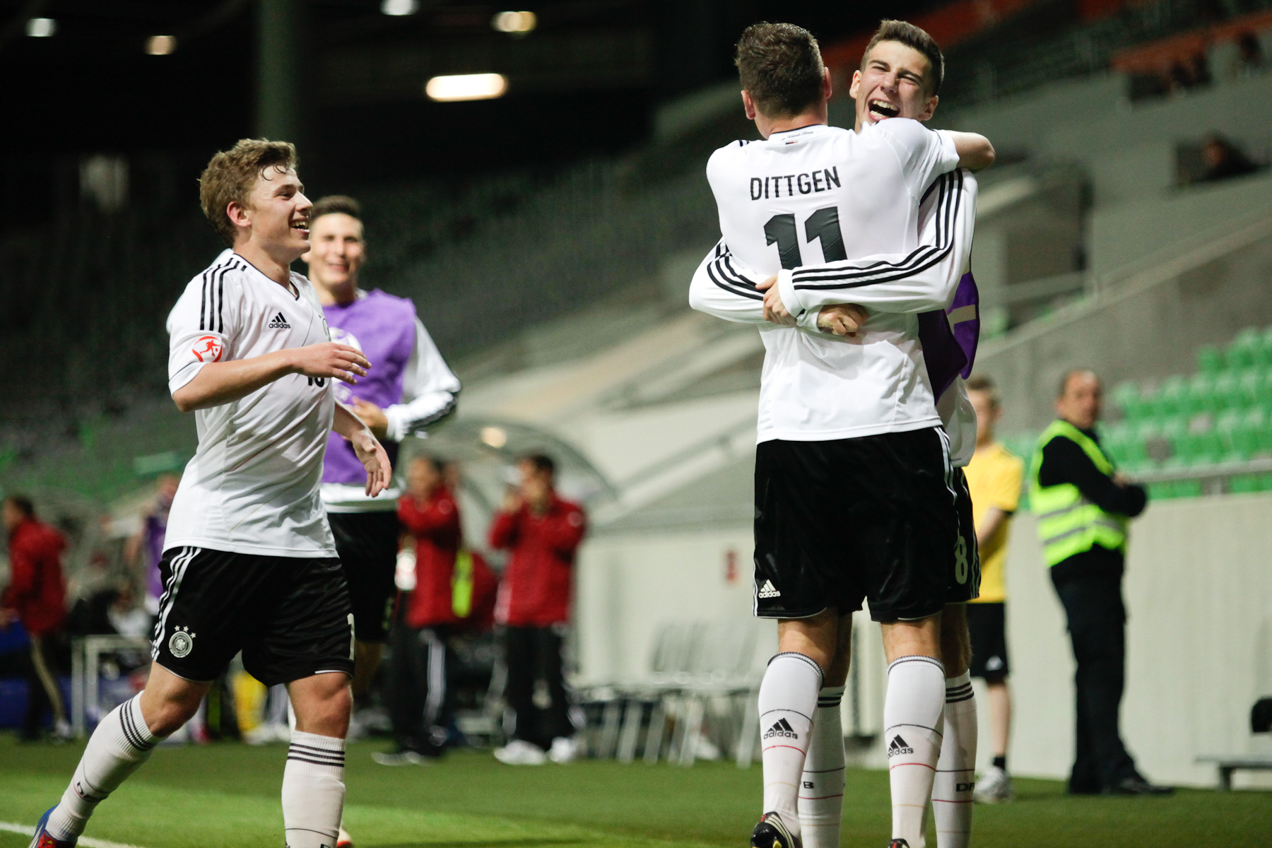 Maximilian Dittgen of Germany celebrates with his team-mates after scoring a goal during the UEFA U-17 European Championship final tournament group match between Germany and France at the SRC Stozice Stadium in Ljubljana, Slovenia, May 10, 2012.